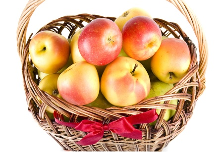 Ripe apples in a basket isolated on white background photo