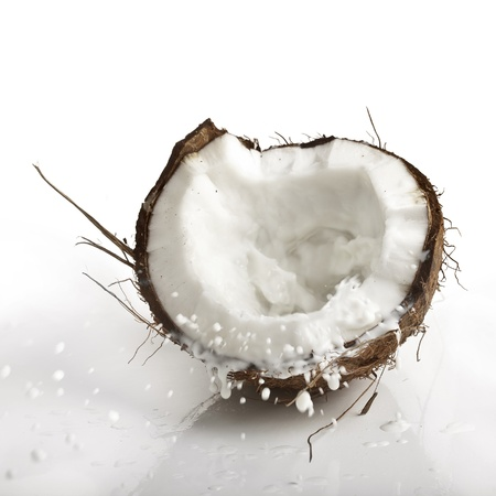 copra: cracked coconut with milk splash Stock Photo