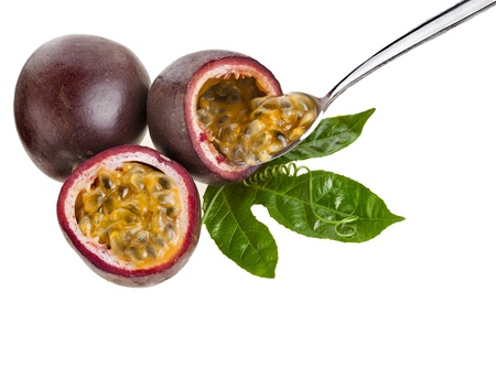 Passion fruit with spoon close up isolated on a white background photo