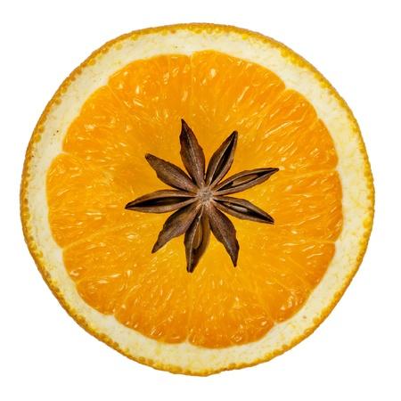 badiane: Sliced orange, anise isolated on a white background