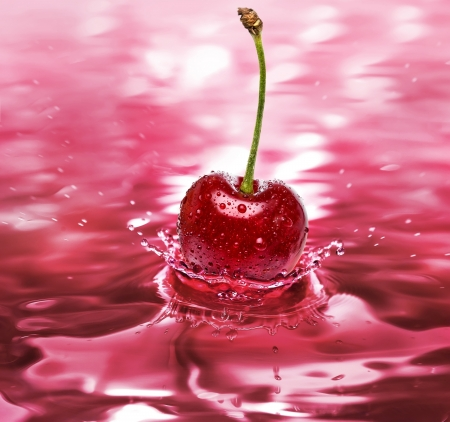 abstract liquor: cherry drink splash close up background