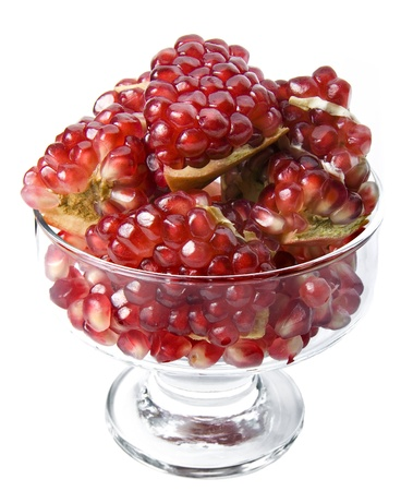 Pomegranate in a glass vase isolated on a white background photo