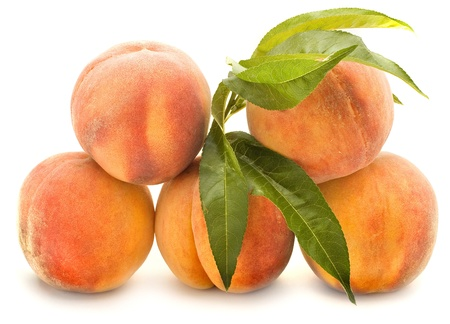 Peaches heap pile isolated on the white background photo