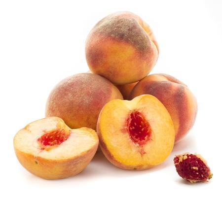 Peaches on white background photo