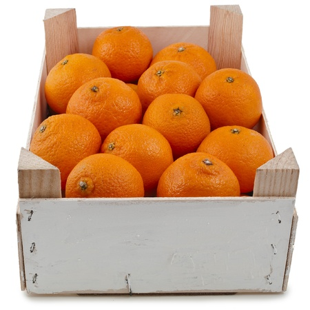 ripe mandarines in wooden crate box isolated on white photo