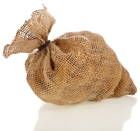 burlap sack: one burlap bag filled raw vegetables isolated on a white background Stock Photo