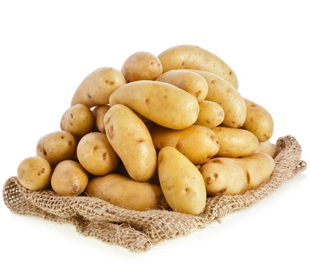 fingerling: Raw potatoes heap with sack cloth isolated on a white background