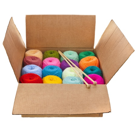 balls of yarn: cardboard box full colorful different thread balls of knitting yarn isolated on white background