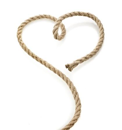 Jute touw met vorm hart op een witte achtergrond Stockfoto