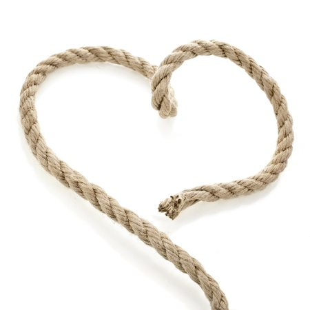 eight note: Jute rope in the shape of heart isolated on white background