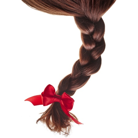 natural hair braided with red ribbon bow isolated on white background Stock Photo