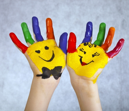 green smiley face: Hands Painted Children on white background