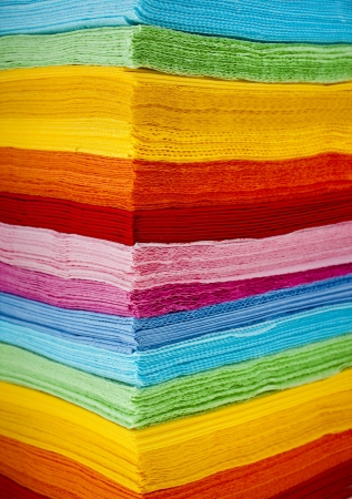 stack of colored strips paper napkins background photo