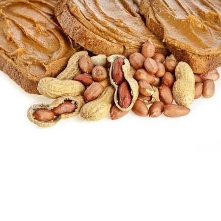 peanut butter sandwich and peanuts on white background photo