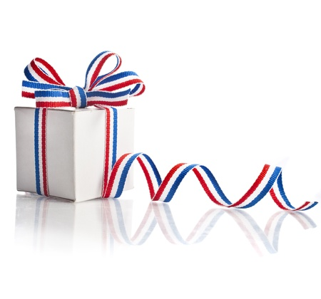 ribbon tape: gift box wrapped striped red blue ribbon tape isolated on white background Stock Photo