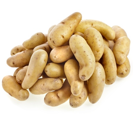 Ratte potatoes heap isolated on a white background photo