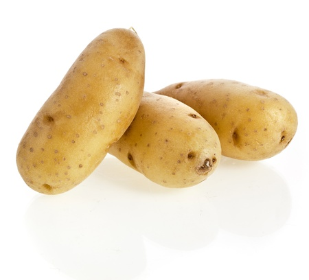 Ratte potatoes heap isolated on a white background