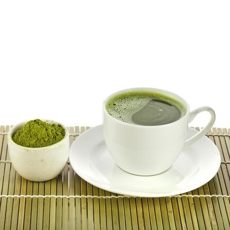 powdered green tea on bamboo napkin texture isolated on white background photo