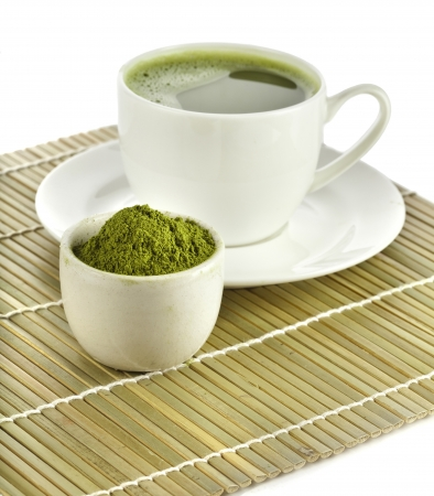powdered green tea on bamboo napkin texture isolated on white background photo