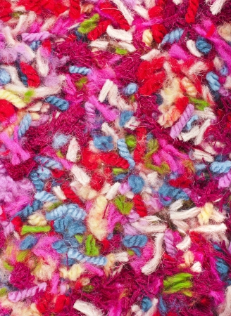 close knit: pieces of colored yarn threads surface top view