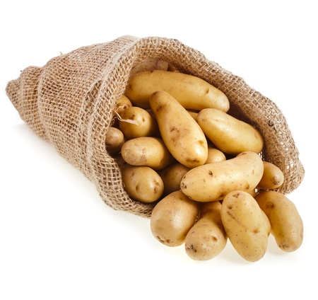 fingerling: Raw potatoes in burlap bag isolated on white background Stock Photo