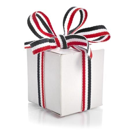 Gift Box Wrapped Ribbon Tape isolated on white background photo