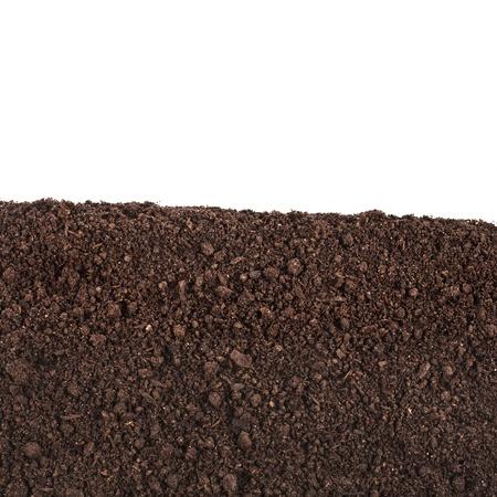 organic soil close up surface isolated on white background Stock Photo