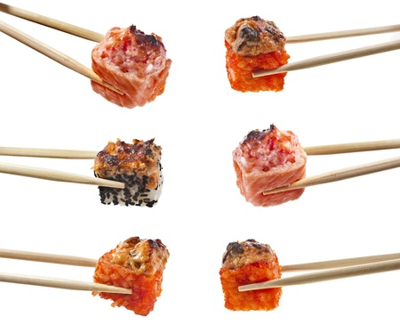 Collection of Japanese sushi rolls with fish and vegetables in wooden chopsticks isolated on white background photo