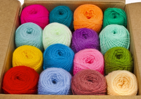Fabric accessories for retail haberdashery, multi-colored balls of wool photo