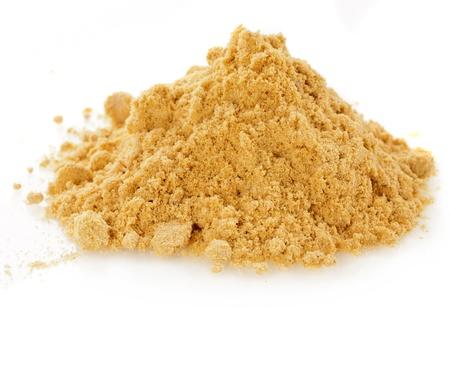pile of mustard powder isolated on white background