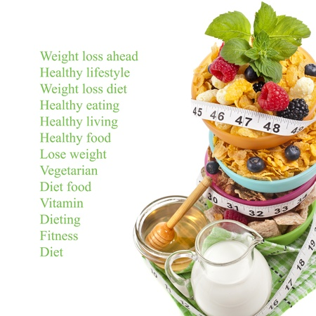 scale weight: Diet weight loss breakfast concept with tape measure, tower stack isolated on a white background