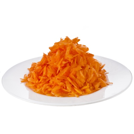 grates: fresh carrots grates in plate isolated on white background Stock Photo