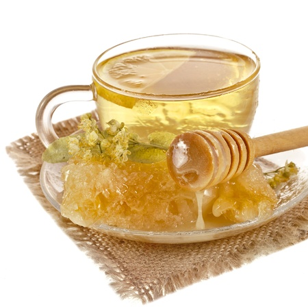 tea cup with linden honey isolated on white background photo