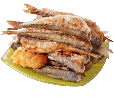 smelt: fried smelts Baltic fish on a dish isolated on white background