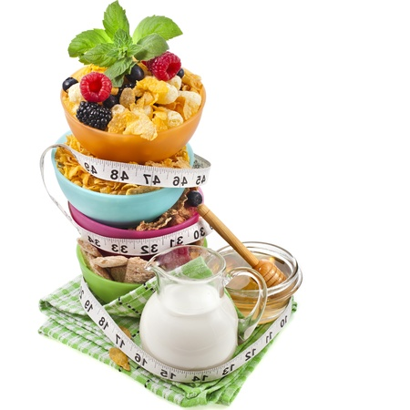 nutritionist: Diet weight loss breakfast concept with tape measure, tower stack isolated on a white background