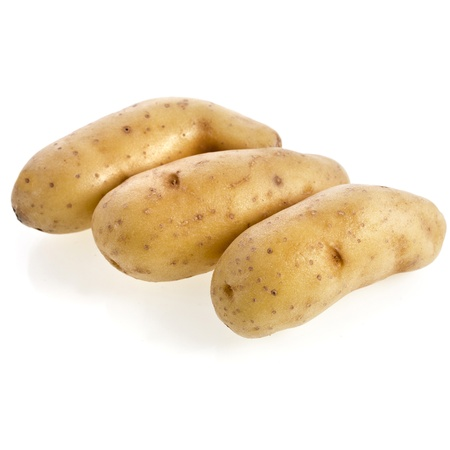 fingerling: Ratte potatoes heap isolated on a white background