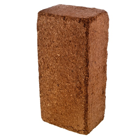 A compressed bale of ground coconut shell fibers  coir , surface background photo