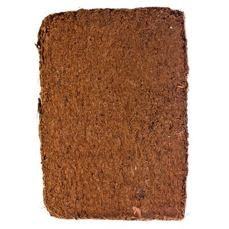 turba: Una bala comprimida de tierra de c?scara de coco fibras de coco, fondo de la superficie