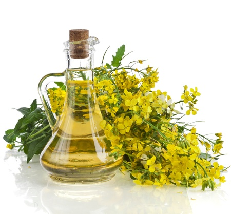 ボトル デカンタ オイル、白い背景で隔離のマスタード、菜の花の花