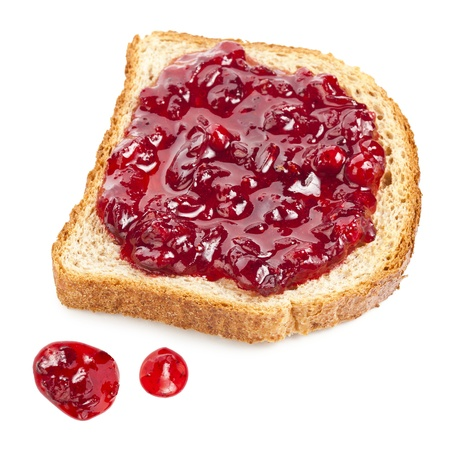 jam sandwich: slice of bread with red jam isolated on white background