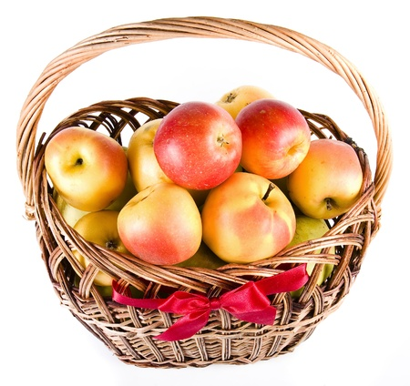 Ripe apples in a basket photo
