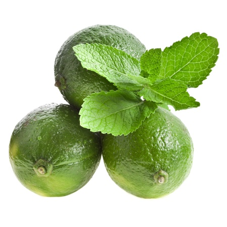 Green limes with mint isolated Stock Photo
