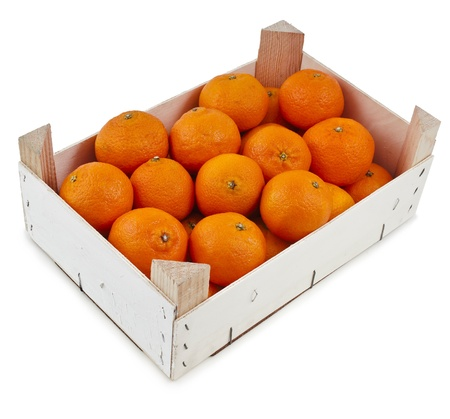 ripe orange mandarins in wooden crate box isolated on white photo
