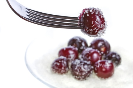 bing: cherries and sprinkle with sugar, on a fork