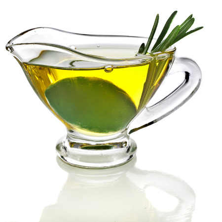 stone bowl: Olive oil sauce with rosemary herbs in the in gravy boat isolated on white background