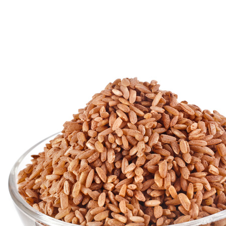 brown rice: brown rice heap isolated on white background
