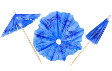 paper umbrella: Cocktail Umbrella isolated against white background