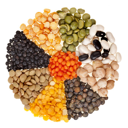 radiate background , rays of different beans, legumes, peas, lentils isolated on white