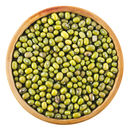 munggo: Green bean or mung bean in wooden bowl, top view close up isolated on a white background Stock Photo