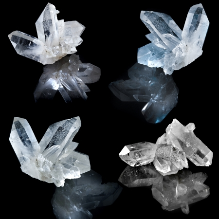 Collection of white natural rock crystal with reflection on black surface background
